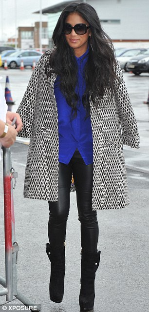 Nicole Scherzinger wears the Sandman Coat in black and white